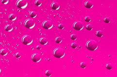 Hot pink round water droplets background with pixel pattern. Round water droplets background with a pattern of pixels in a hot pink colour Royalty Free Stock Images