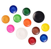 Round watercolor paints isolated on a white Stock Photos