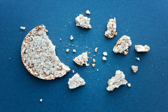 Round wheat bread and crumbs Stock Photos