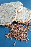 Round wheat bread and crumbs. Buckwheat Royalty Free Stock Image