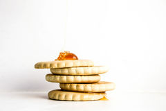 A round wheat cookie on a friend with a slide Stock Photos