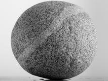 Round whimsical stone. Isolated studio royalty free stock image
