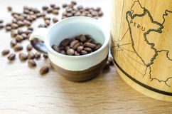 Round White and Brown Mug With Coffee Beans Stock Images