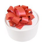 Round white gift box. With a red bow Stock Photo