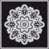 Round white lace ornament on black Royalty Free Stock Images