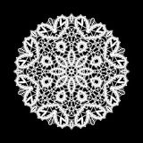 Round white lace ornament on black Royalty Free Stock Photography