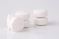 Round white pills Royalty Free Stock Photos