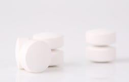 Round white pills Stock Image