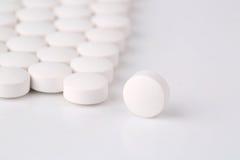 Round white pills Royalty Free Stock Photo