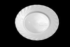 Round white plate isolated on black top view Royalty Free Stock Images