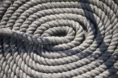 Round white rope on ship Stock Images