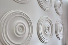 Round white stucco on the wall Stock Photos