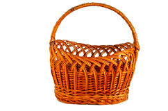 Round wicker basket of brown color with handle on a white background. Handmade royalty free stock photography