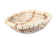 Round wicker basket with a white background. Stock Images