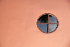 Round window. Round window with a flat wall Stock Photos