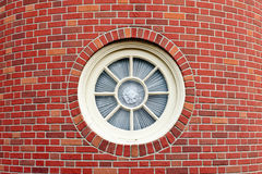 Round window in brick tower Royalty Free Stock Images