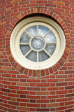 Round Window in a Brick Tower Stock Photography