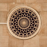Round window decorated with rosette Stock Images
