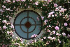 Round Window with Flowers Royalty Free Stock Images