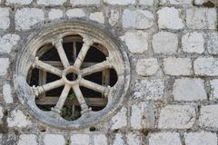 Round window in an old stone wall Stock Image