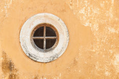 Round Window in an old wall Royalty Free Stock Photos