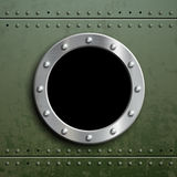 Round window porthole on green metal background. Military armor Royalty Free Stock Photography