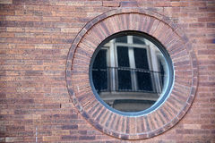 Round window with reflection Stock Photo