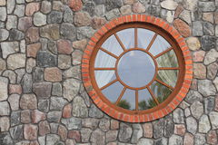 Round window on the right Stock Photography