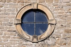 Round window in stone frame. Stock Images