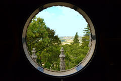 Round window to landscape in Portugal Stock Photography