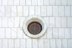 Round Window. At white marble wall of church Royalty Free Stock Image