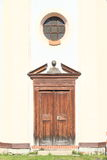 Round window and wooden door Royalty Free Stock Image