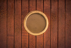 Round window on wooden wall Stock Image