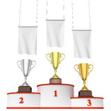 Round winners podium with trophy cups and blank white flags. Sports winning, championship and competition success concept - three winners trophy cups on round Royalty Free Stock Photography