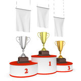 Round winners podium with trophy cups and blank white flags. Sports winning, championship and competition success concept - three winners trophy cups on round Royalty Free Stock Images