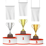Round winners podium, trophy cups and blank white flags. Sports winning, championship and competition success concept - three winners trophy cups on round sports Royalty Free Stock Image