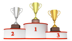 Round winners podium with trophy cups closeup. Sports winning and championship and competition success concept - golden, silver and bronze winners trophy cups on Royalty Free Stock Images