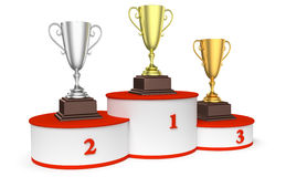 Round winners podium with trophy cups closeup. Sports winning and championship and competition success concept - golden, silver and bronze winners trophy cups on Royalty Free Stock Photos