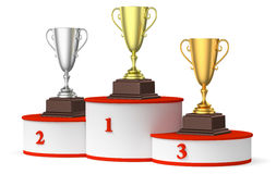 Round winners podium with trophy cups. Sports winning and championship and competition success concept - golden, silver and bronze winners trophy cups on the Stock Photo