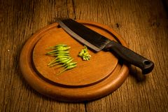 Round wood Chopping cutting board. chili peppers green and red. stock image