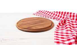 Round wood pizza cutting board and red napkin on wooden table isolated on white background. Top view and copy space, Empty stock photos