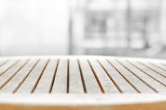 Round wood table top on blur gray background royalty free stock photo