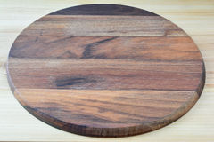 Round wooden chopping board Stock Photo