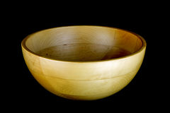 Round Wooden Fruit Bowl on Black Background Royalty Free Stock Images