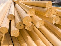 Round wooden logs. For construction of a rural house royalty free stock images