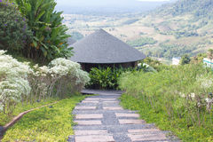 Round wooden roof hut house in the green hills Stock Photo