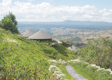 Round wooden roof hut house in the green hills Royalty Free Stock Image