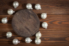Round wooden stand and christmas toys on wooden background conce Stock Photo