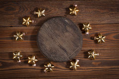 Round wooden stand and christmas toys on wooden background conce Stock Images