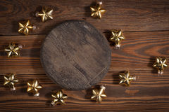 Round wooden stand and christmas toys on wooden background conce Royalty Free Stock Photo
